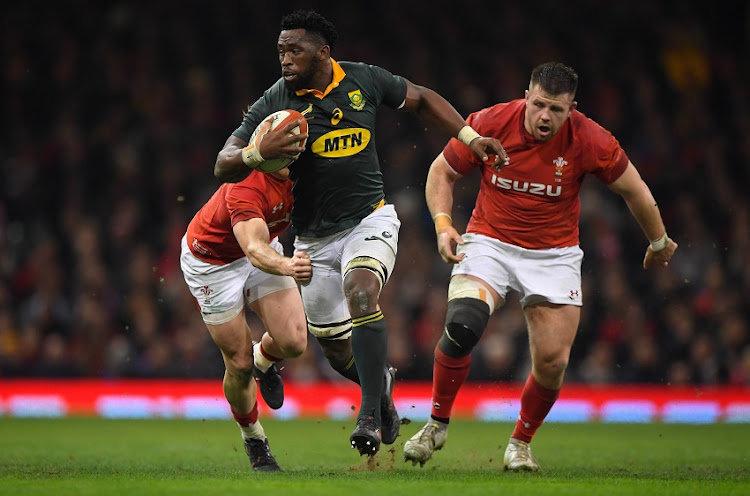 Wales scrum half Aled Davies (l) and Rob Evans chase Springboks player Siya Kolisi during the International between Wales and South Africa at at Principality Stadium on December 2, 2017 in Cardiff, Wales.