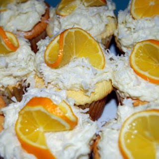 Filled Meyer lemon cupcakes w/ coconut frosting