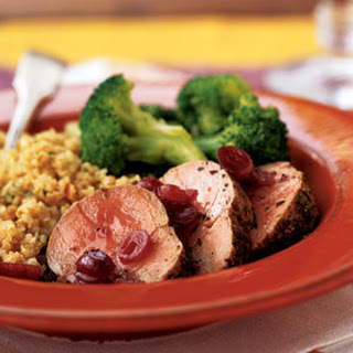 Roasted Pork Tenderloin Medallions with Dried Cranberry Sauce.