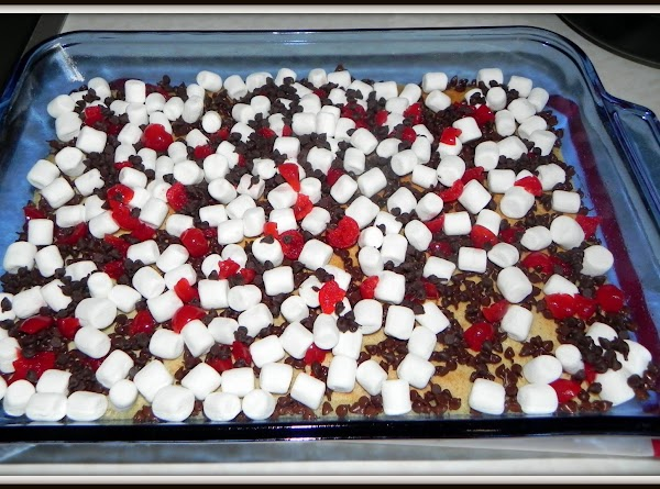 Bake for 20 minutes. Remove from oven. Sprinkle with marshmallows, chips and cherries.
