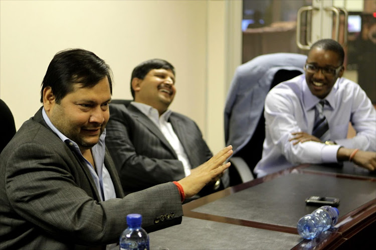 Indian businessmen Ajay and Atul Gupta, and Duduzane Zuma at the New Age Newspaper's offices in Midrand, Johannesburg, South Africa on 4 March 2011.