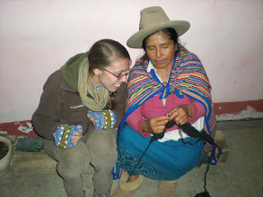 Photo: Menda learning to knit from our made