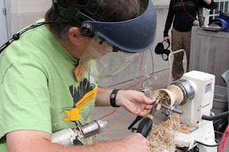 Photo: Tim hollowing a spalted maple bowl.