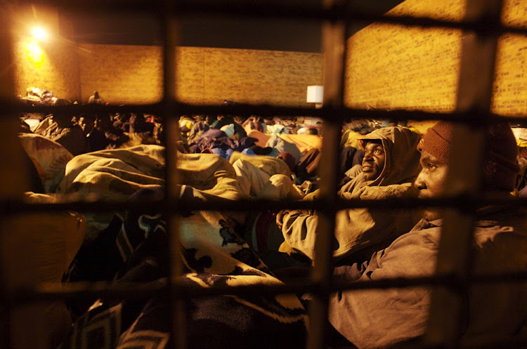 Hundreds of foreign residents of Alexandra settle down for the night at Alexandra Police Station during xenophobic violence in Alexandra Township in November 2008.    File picture: SUNDAY TIMES