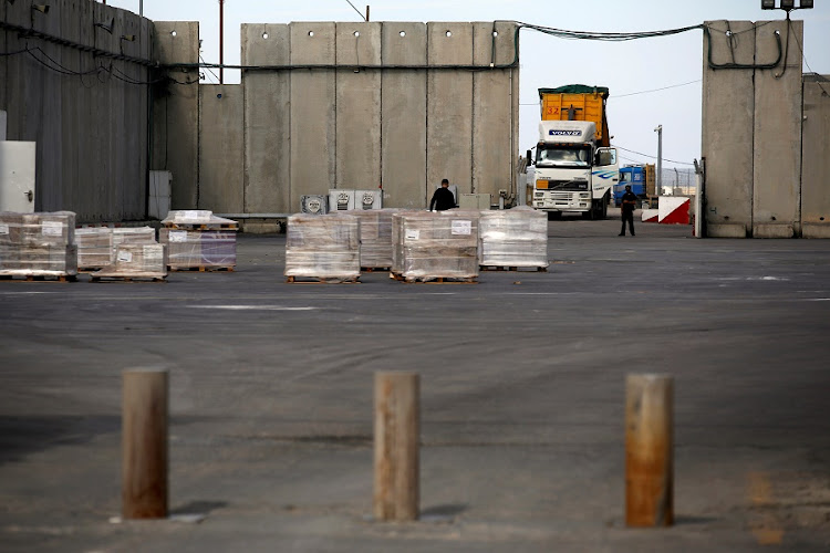 FILE PHOTO: A truck parks next to a security barrier inside the Kerem Shalom border crossing terminal between Israel and Gaza Strip on January 16 2018.Picture: REUTERS/Amir Cohen