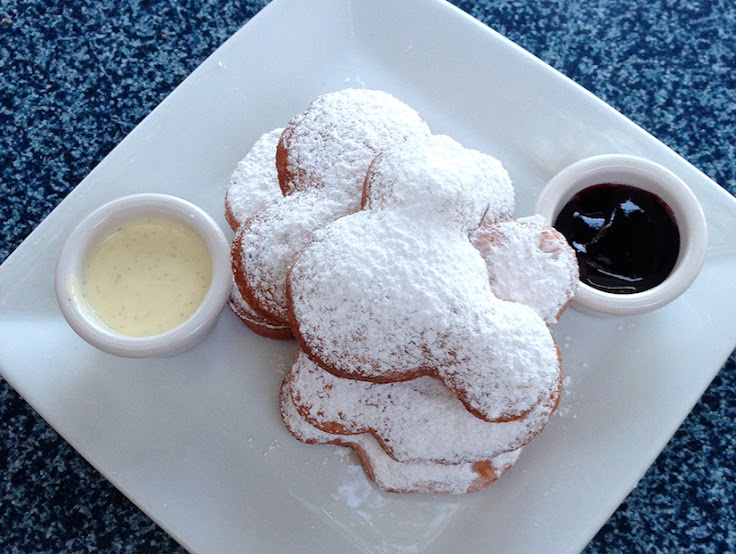 Is there enough powdered sugar? Mickey-shaped beignets from the Mint Julep Bar. Photo: Cam Bowman.