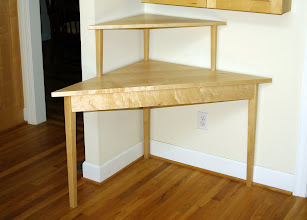 Photo: Maple Corner Desk.  Unfortunately, the only available corner in my house isn't quite big enough to contain it.  The front measures 52 inches and each side is 37 inches. Can you find the secret drawer?