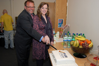 Photo: Paul Martin and Shahnaz Ali celebrate the successful launch of 'Pride in Practice' by cutting the cake