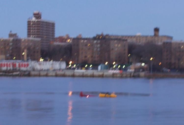 A helicopter is seen crashed in New York City's East River March 11, 2018 in this picture obtained from social media.