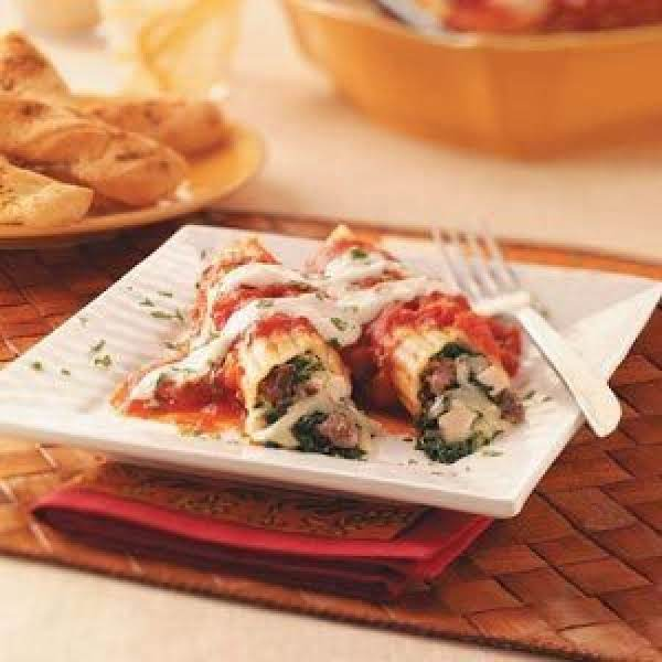 Spinach, Pesto, And Beef Stuffed Manicotti