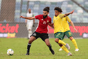 Rabia Ramadan Alsshadi of Libya challenged by Keagan Dolly of South Africa during the 2019 African Cup Of Nations Qualifier match between South Africa and Libya at the Moses Mabhida Stadium, Durban on 08 September 2018.