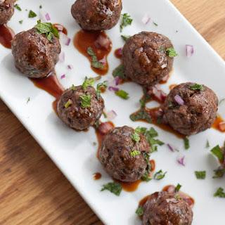 Mini Stuffed Lamb Meatballs With Pomegranate Glaze.