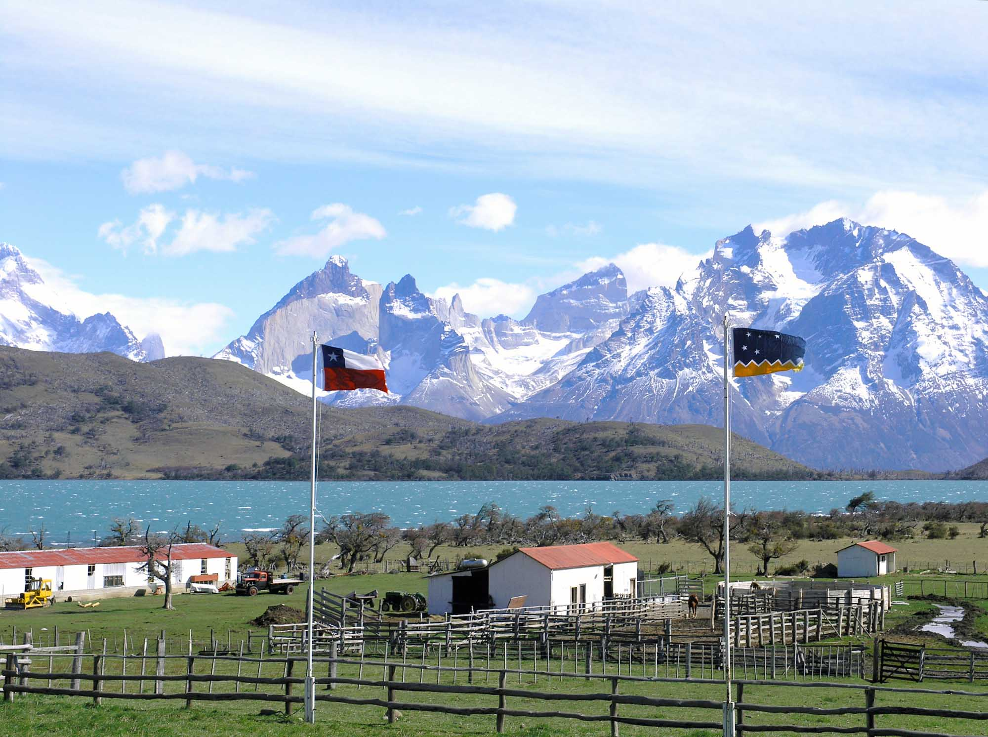 A farm displays the flags of Patagonia and Chile.