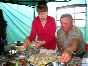 Photo: Nadesda presents a special Kyrgiz dish in honor of Liz's previous work in Kyrgistan