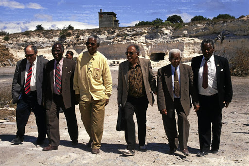 The quarry: The Rivonia triallists revisit Robben Island: Kathrada is seen to the right of Nelson Mandela. Picture: GETTY IMAGES/CORBIS/LOUISE GUBB