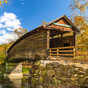 Humpback Bridge in Autumn Colors by Norma Brandsberg - Buildings & Architecture Bridges & Suspended Structures ( old, mountain, photograph, www.elegantfinephotography.com, midland, landscape, alleghany highland, norma brandsberg, photography, hiking, turnpike, jackson, area attraction, creek, trail, weekend, photographer, 64, kanawha, trip, opportunities, black, quaint, covered, 1857, humpback bridge, white, scenic, photo opportunity, james, nbrandsberg@gmail.com, charm, covington virginia, county, top thing to do, scene, shenandoah valley, river,  )