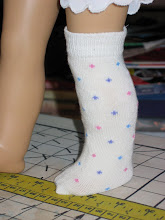 Photo: When you put the socks on, make sure the seam runs down the back of the leg and under the foot. The toe will be a little pointy, but that's OK. Your doll won't mind! But be careful with shoes, some shoes may not fit when your doll is wearing socks.  http://www.beds-n-blankies.com/howto.htm
