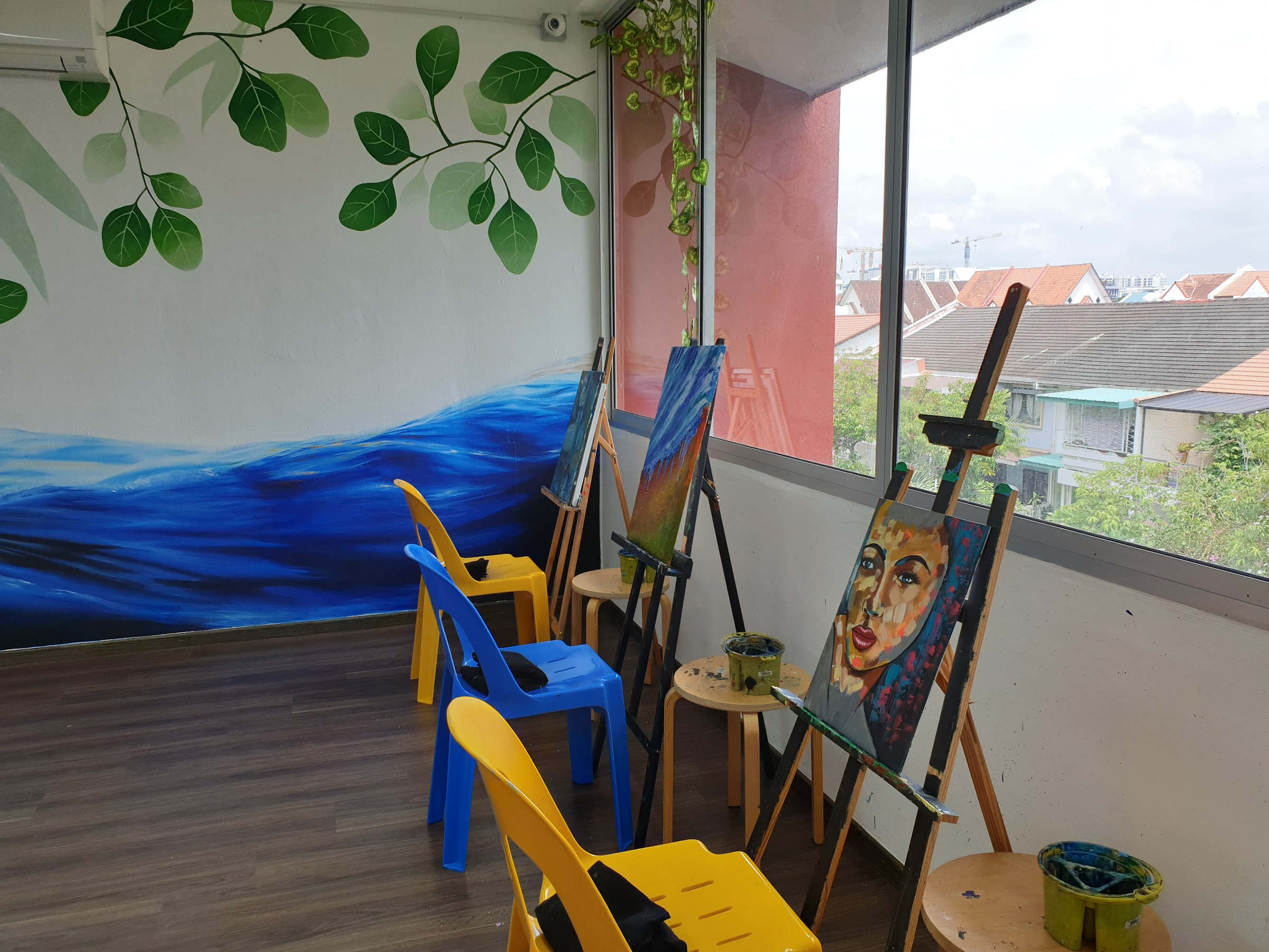 Enjoy the serenity of our studio. Beautiful hand painted mural decorates the walls. Surrounded by music of your choice, paint your heart away!