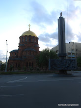 Photo: The first brick building in Novosibirsk (a church) and a monument to WWII