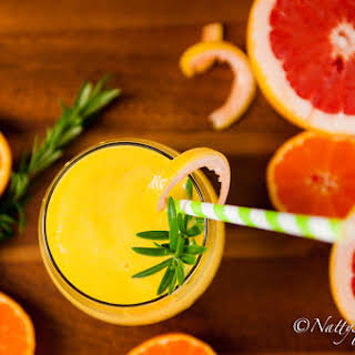 High Vitamin C Grapefruit, Orange, Mango and fresh  Rosemary Smoothie.