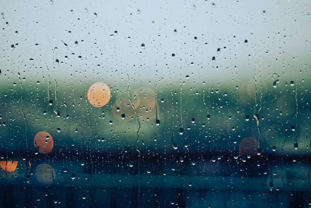 A glass window with raindrops on it.