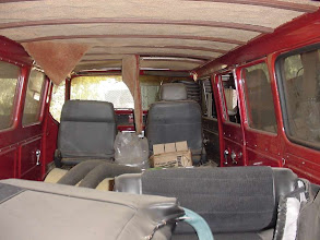 "Photo: Ceiling has panels of carpet glued to the original liner.  Needs some help! The ribs have been covered with detailed wood strips.  Interior was standard ""fawn"" gold.  Someone did a great job re-spraying the entire interior in a nice red"