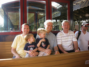 Photo: Day 2 - Three Gradys and Two RIchards riding the Disney train - From left to right: Grady, Richard, Grady, Richard, Grady