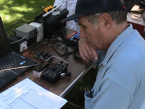 Photo: Earl Wilson K6GPB copying Morse Code on the Elecraft KX1