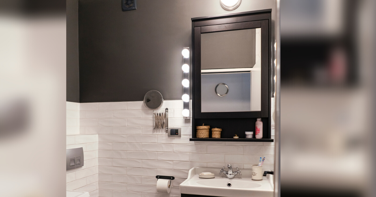 White bathroom sink with mirror and shelf ontop
