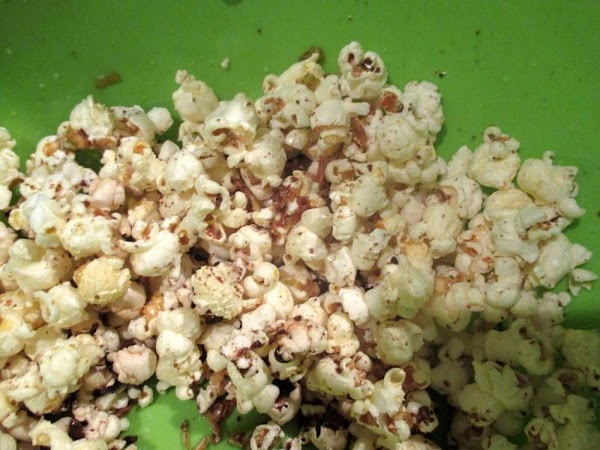 Pour the butter mixture over warm popcorn, in a large bowl and mix thoroughly....