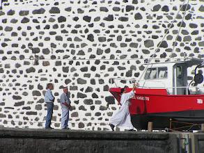 Photo: Спуск сейнера на воду - батюшка старается./Christening the boat before the launch