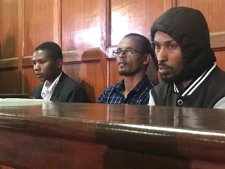 Mohammed Abikar, Hassan Edin Hassan and Tanzanian Rashid Charles Mberesero when they appeared before a Milimani law courts on June 19, 2019.