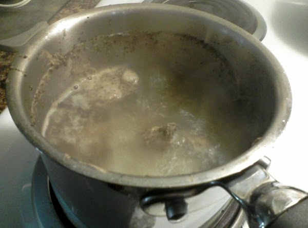 Rinse chicken and remove giblets. At this point I put the giblets in a...