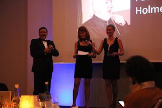 "Photo: Yanina Dubeykovskaya, announcing the C4F award winner of ""Titan Web 2.0 of the Future"""