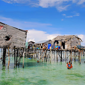 by Alvin Ngow - Landscapes Travel ( freedom, moods, innocent, children, landscape, fishing village, people, water house, photography, sabah, borneo, asian, island, clear, child, life, blue sky, sky, village, nature, poverty, transport, woman, family, semporna, asia, gypsies, bajau laut, travel locations, water, houses, play, sea, tourism, malaysia, kids, seascape, boat, relaxing, waterscapes, holiday, wooden, blue, background, outdoor, sea gypsy, island hopping, landscapes, mood factory,  )