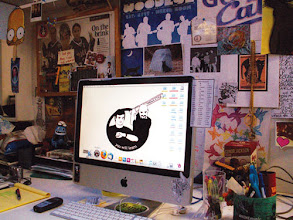 Photo: Reader Amy from Fort Worth has a work area full of fantasticness — just what we'd expect from a graphic artist. But while the desk is busy with cluttery fun, the desktop is a work of simplicity.