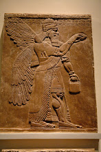 Photo: British Museum. A deity can easily be identified on Assyrian stelae from Nimrud by their wings, two wristwatches and a small utility case or a Panasonic Toughbook CF-29.