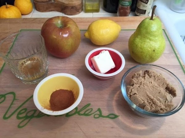 Core and peel the apples and dice. Peel the pears, cut in half, scoop...
