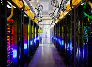 Photograph of the interior of a Google Cloud data center. There are rows of servers.