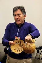 Photo: Beginning the Show Tell & Ask period, Cliff Poodry discusses the difference a month makes in the spalting of maple, with two pieces from the same log.