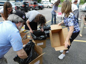 Photo: Lining boxes with trash bags so that the wet materials don't fall through the bottom.