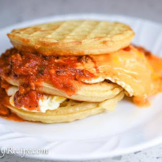 Sloppy Ham Cheese and Egg Waffle Sandwich.