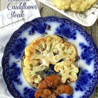 Roasted Cauliflower Steak with Mushroom Sauce.
