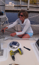 Photo: Anne working topside to install the handrails