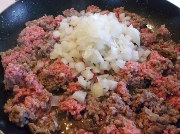 Add ground beef, onions, ground black pepper and salt to skillet.