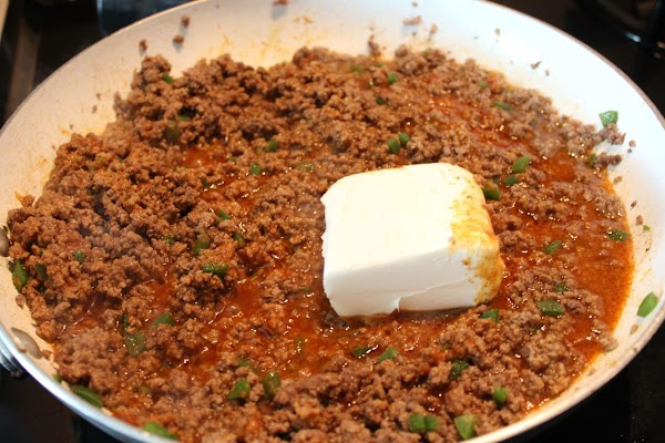 Add cream cheese, cover and simmer until cheese is melted.