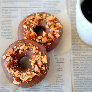 Chocolate Doughnuts with Butterscotch Glaze and Salted Almonds.