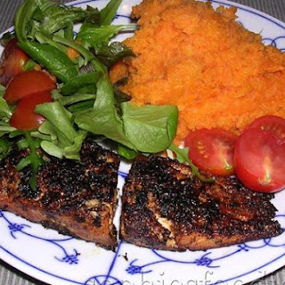 Marinated Salmon In A Spicy Crust With Sweet Potato Mash, Served With A Salad & Cherry Tomatoes