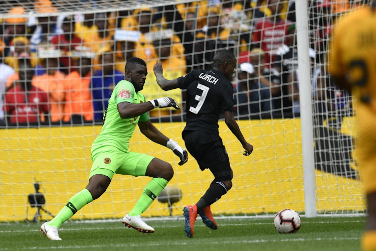 Orlando Pirates winger Thembinkosi Lorch rounds Kaizer Chiefs goalkeeper Daniel Akpeyi before scoring the equalising goal in the 1-1 Absa Premiership draw at FNB Stadium in Johannesburg on February 9 2019.