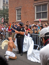 Photo: Flirting with a police officer.  The Heritage of Pride gay pride march, Christopher Street and Waverly Place, Greenwich Village, 26 June 2011. (Photograph by Elyaqim Mosheh Adam.)